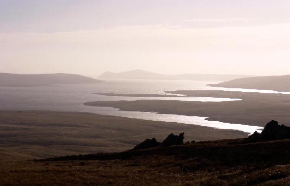 San Carlos (Falkland Islands) seen from nearby mountains.